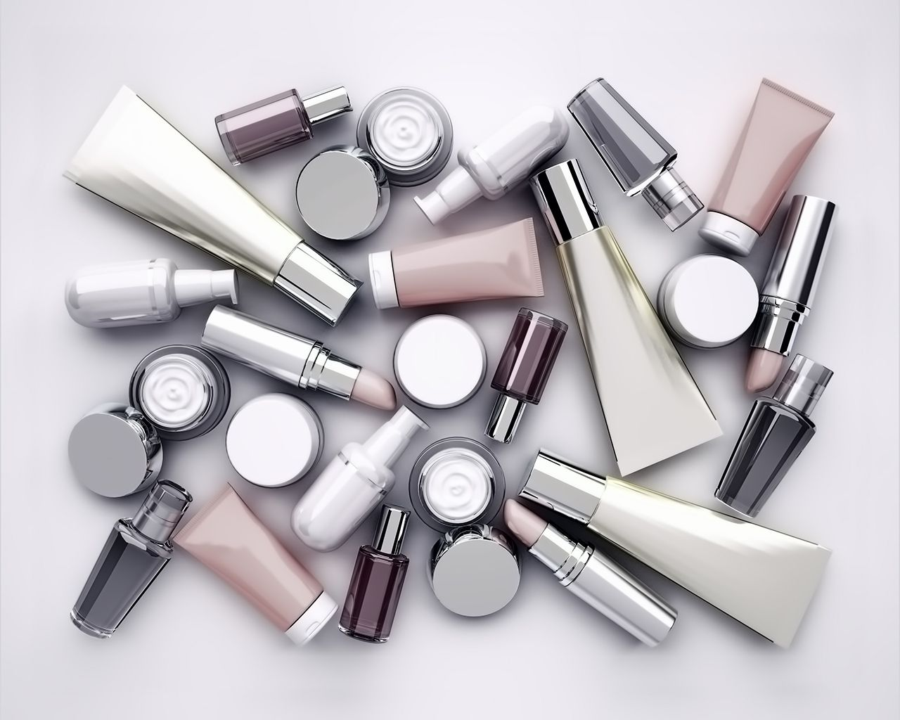 Cosmetic products, lipstik and perfume on gray background. Top view.